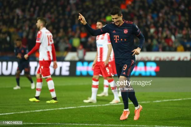 Robert Lewandowski of FC Bayern Munich celebrates after scoring his team's third goal during the UEFA Champions League group B match between Crvena...