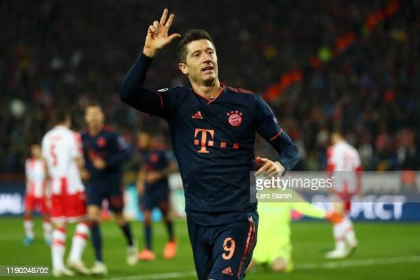 Robert Lewandowski of FC Bayern Munich celebrates after scoring his team's fourth goal during the UEFA Champions League group B match between Crvena...