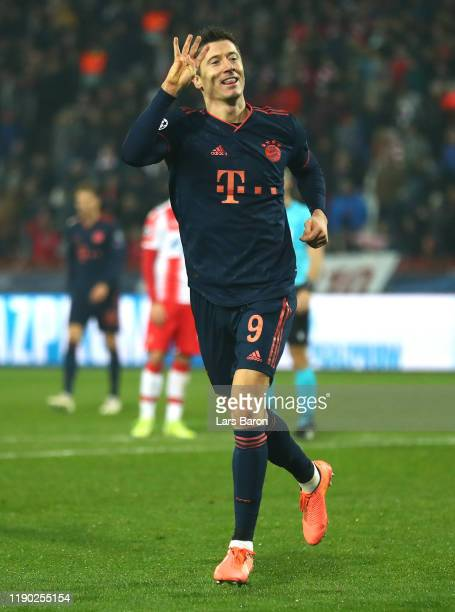 Robert Lewandowski of FC Bayern Munich celebrates after scoring his team's fifth goal during the UEFA Champions League group B match between Crvena...