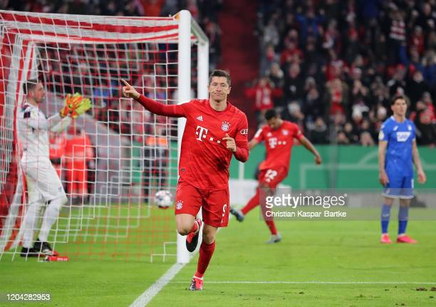 Robert Lewandowski of FC Bayern Munich celebrates after scoring his team's fourth goal during the DFB Cup round of sixteen match between FC Bayern...