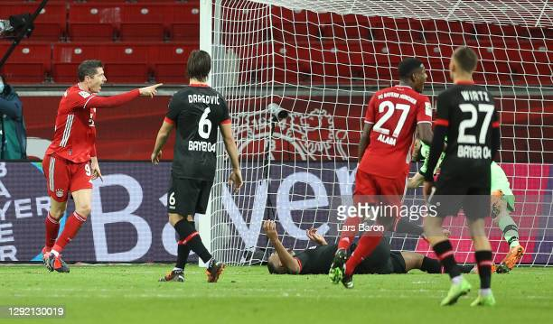 Robert Lewandowski of FC Bayern Munich celebrates after scoring his team's first goal during the Bundesliga match between Bayer 04 Leverkusen and FC...
