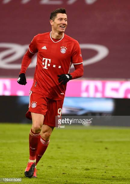 Robert Lewandowski of FC Bayern Munich celebrates after scoring their sides fifth goal during the Bundesliga match between FC Bayern Muenchen and 1....