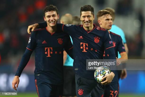 Robert Lewandowski of FC Bayern Munich celebrates with Benjamin Pavard following the UEFA Champions League group B match between Crvena Zvezda and...
