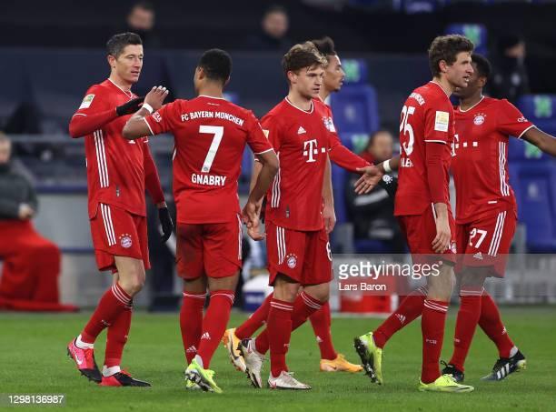 Robert Lewandowski of FC Bayern Munich celebrates with team mates Serge Gnabry, Joshua Kimmich and Thomas Muller after scoring their side's second...