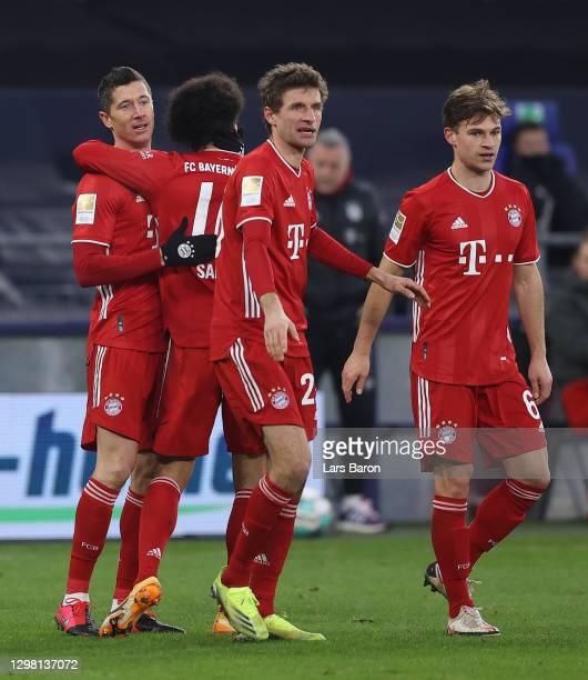 Robert Lewandowski of FC Bayern Munich celebrates with team mates Leroy Sane, Thomas Muller and Joshua Kimmich after scoring their side's second goal...