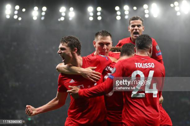 Robert Lewandowski of FC Bayern Munich celebrates with teammates after scoring his team's second goal during the UEFA Champions League group B match...