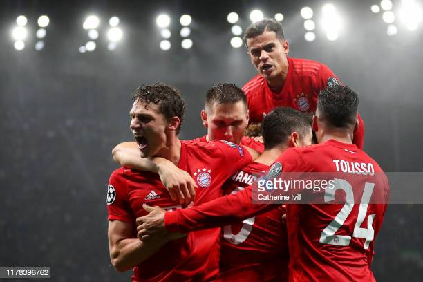 Robert Lewandowski of FC Bayern Munich celebrates with teammates after scoring his team's second goal as Philippe Coutinho jumps on top during the...