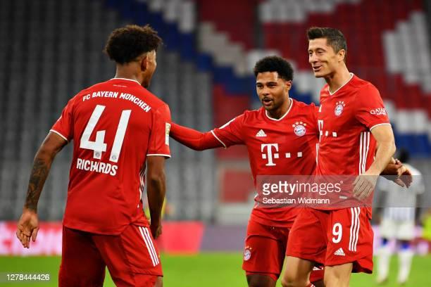 Robert Lewandowski of FC Bayern Munich celebrates with teammates after scoring his sides second goal during the Bundesliga match between FC Bayern...