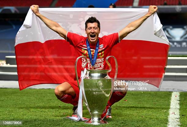 Robert Lewandowski of FC Bayern Munich celebrates with the UEFA Champions League Trophy following his team's victory in the UEFA Champions League...