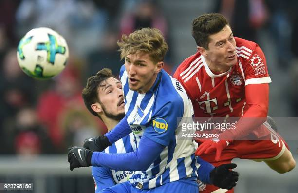 Robert Lewandowski of FC Bayern Munich in action against Mathew Leckie and Niklas Stark of Hertha BSC Berlin during the German Bundesliga soccer...