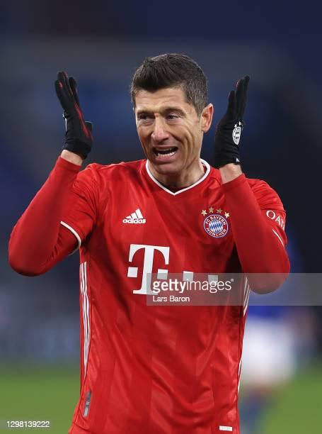 Robert Lewandowski of FC Bayern Munich reacts during the Bundesliga match between FC Schalke 04 and FC Bayern Muenchen at Veltins-Arena on January...