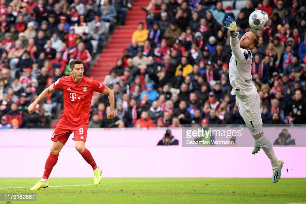 Robert Lewandowski of FC Bayern Munich scores his sides first goal during the Bundesliga match between FC Bayern Muenchen and TSG 1899 Hoffenheim at...