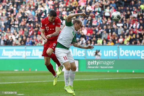 Robert Lewandowski of FC Bayern Munich scores his side's first goal during the Bundesliga match between FC Augsburg and FC Bayern Muenchen at...