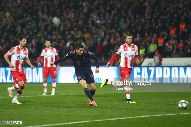 Robert Lewandowski of FC Bayern Munich scores his team's fifth goal during the UEFA Champions League group B match between Crvena Zvezda and Bayern...