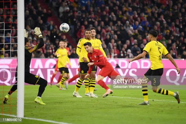 Robert Lewandowski of FC Bayern Munich scores his team's first goal during the Bundesliga match between FC Bayern Muenchen and Borussia Dortmund at...