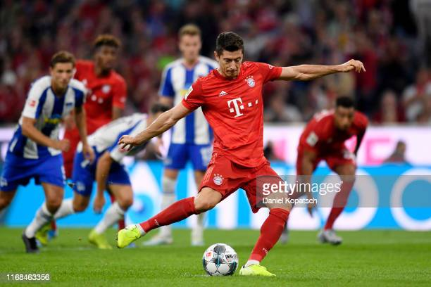 Robert Lewandowski of FC Bayern Munich scores his team's second goal from the penalty spot during the Bundesliga match between FC Bayern Muenchen and...