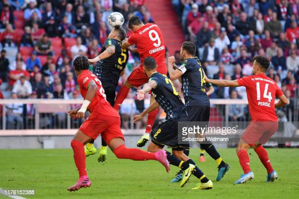 Robert Lewandowski of FC Bayern Munich scores his team's second goal during the Bundesliga match between FC Bayern Muenchen and 1. FC Koeln at...