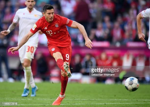 Robert Lewandowski of FC Bayern Munich scores his team's second goal during the Bundesliga match between FC Bayern Muenchen and 1. FC Union Berlin at...