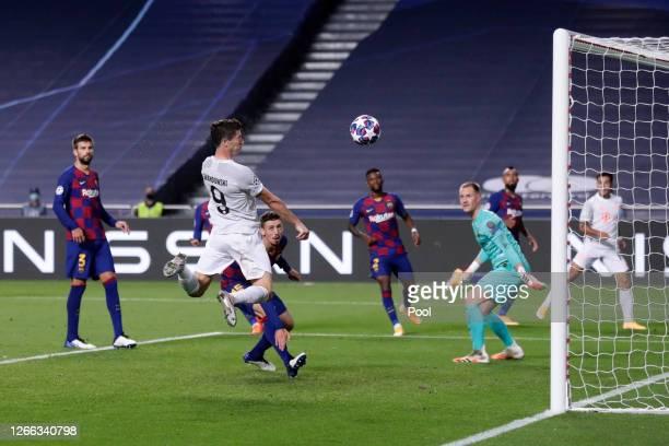 Robert Lewandowski of FC Bayern Munich scores his team's sixth goal during the UEFA Champions League Quarter Final match between Barcelona and Bayern...