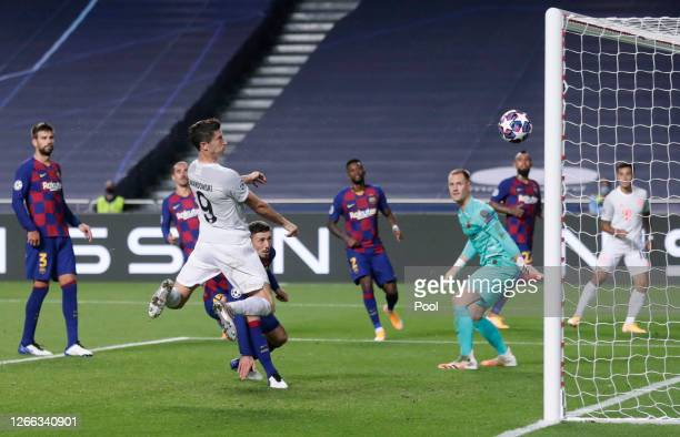 Robert Lewandowski of FC Bayern Munich scores his team's sixth goal during the UEFA Champions League Quarter Final match between Barcelona and Bayern...