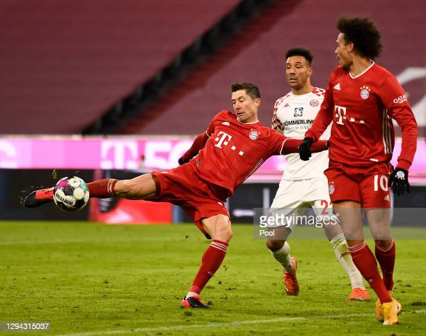 Robert Lewandowski of FC Bayern Munich scores their sides fifth goal during the Bundesliga match between FC Bayern Muenchen and 1. FSV Mainz 05 at...