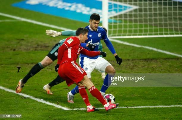 Robert Lewandowski of FC Bayern Munich scores their side's second goal during the Bundesliga match between FC Schalke 04 and FC Bayern Muenchen at...