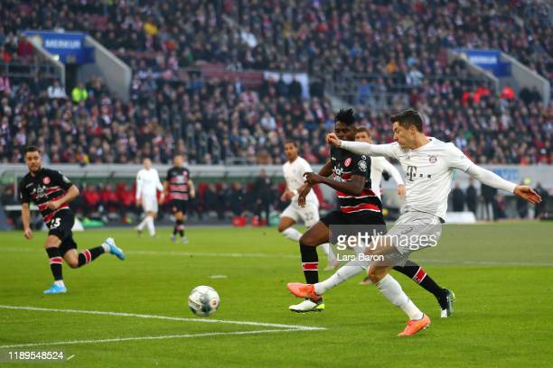 Robert Lewandowski of FC Bayern Munich shoots during the Bundesliga match between Fortuna Duesseldorf and FC Bayern Muenchen at Merkur Spiel-Arena on...