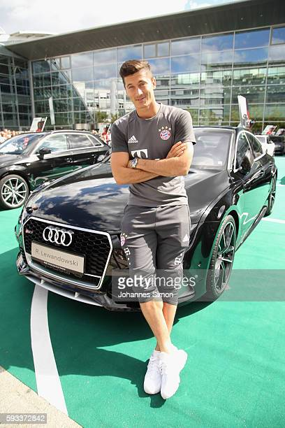 Robert Lewandowski of FC Bayern poses with his new Audi car during the official car handover at Audi Forum on August 22 2016 in Ingolstadt Germany
