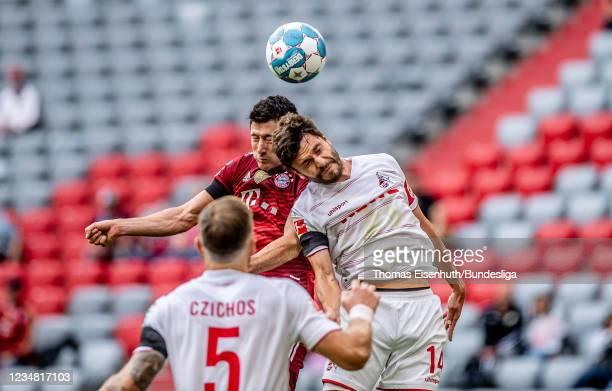 Robert Lewandowski of München in action with Jonas Hector of Köln during the Bundesliga match between FC Bayern München and 1. FC Köln at Allianz...