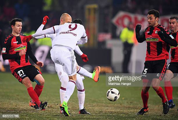 Robert Lewandowski of Muechen scores the second goal during the Bundesliga match between SC Freiburg and Bayern Muenchen at SchwarzwaldStadion on...