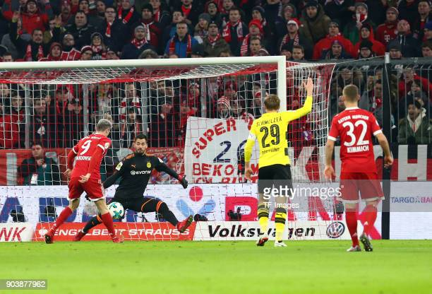 Robert Lewandowski of Muenchen and Goalkeeper Roman Buerki of Dortmund in action during the DFB Cup match between Bayern Muenchen and Borussia...