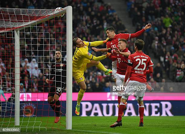 Robert Lewandowski of Muenchen and Joshua Kimmich of Muenchen miss to score against Goalkeeper Bernd Leno of Leverkusen during the Bundesliga match...