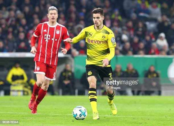 Robert Lewandowski of Muenchen and Julian Weigl of Dortmund battle for the ball during the DFB Cup match between Bayern Muenchen and Borussia...