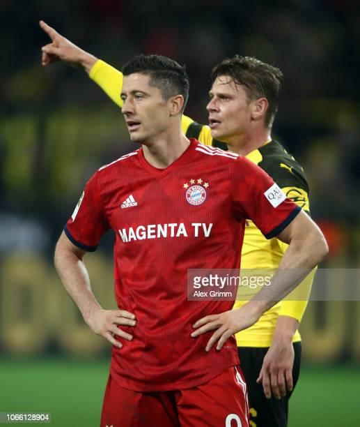 Robert Lewandowski of Muenchen and Lukas Piszczek of Dortmund react during the Bundesliga match between Borussia Dortmund and FC Bayern Muenchen at...