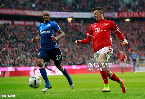 Robert Lewandowski of Muenchen and Naldo of Schalke battle for the ball during the Bundesliga match between Bayern Muenchen and FC Schalke 04 at...