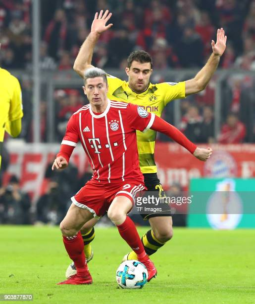Robert Lewandowski of Muenchen and Sokratis Papastathopoulos of Dortmund battle for the ball during the DFB Cup match between Bayern Muenchen and...