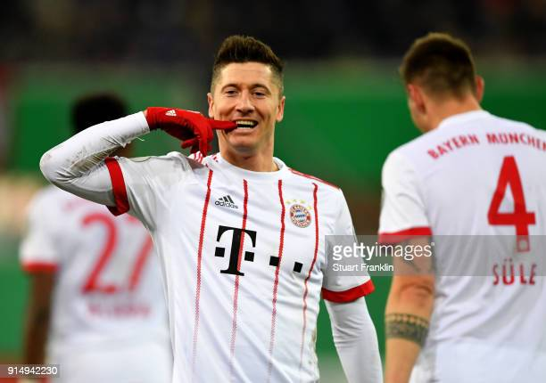 Robert Lewandowski of Muenchen celbrates after he scores the 2nd goal during the DFB Cup quarter final match between SC Paderborn and Bayern Muenchen...