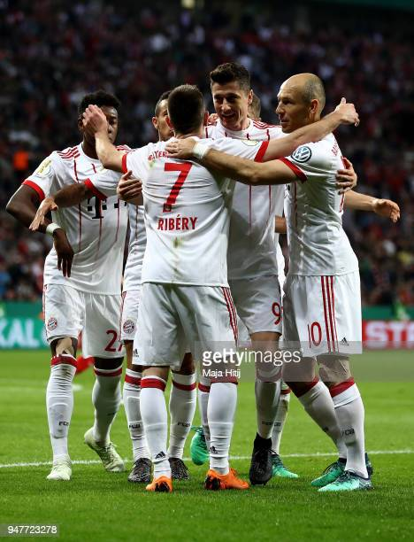 Robert Lewandowski of Muenchen celebrate with his team mates after he scores the 2nd goal during the DFB Cup semi final match between Bayer 04...