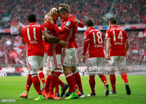 Robert Lewandowski of Muenchen celebrate with team mate Arjen Robben after he scores the opening goal during the Bundesliga match between Bayern...