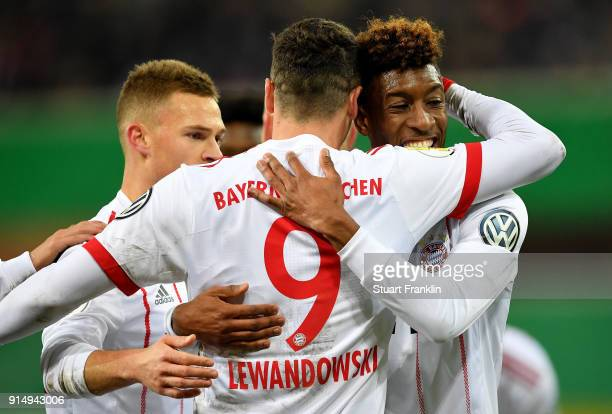 Robert Lewandowski of Muenchen celebrate with team mate Kingsley Coman after he scores the 2nd goal during the DFB Cup quarter final match between SC...