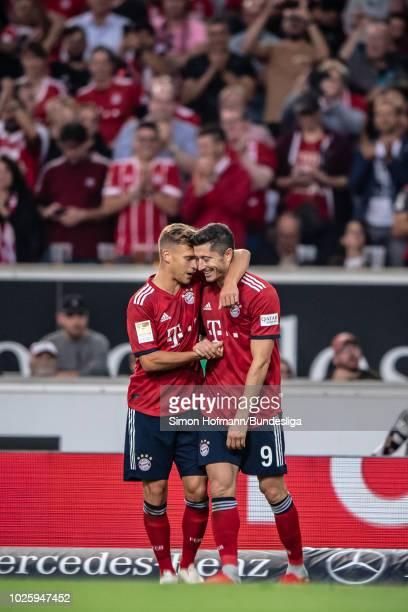 Robert Lewandowski of Muenchen celebrates a goal with team mate Joshua Kimmich during the Bundesliga match between VfB Stuttgart and FC Bayern...