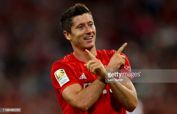 Robert Lewandowski of Muenchen celebrates after scoring his teams first goal during the Bundesliga match between FC Bayern Muenchen and Hertha BSC at...