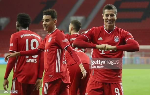 Robert Lewandowski of Muenchen celebrates after scoring his teams second goal during the Bundesliga match between Bayer 04 Leverkusen and FC Bayern...