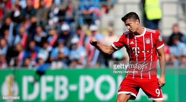 Robert Lewandowski of Muenchen celebrates after scoring his team's opening goal during the DFB Cup first round match between Chemnitzer FC and FC...