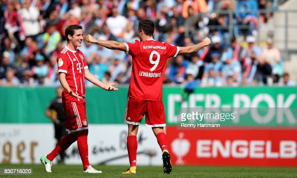 Robert Lewandowski of Muenchen celebrates after scoring his team's opening goal with Sebastian Rudy of Muenchen during the DFB Cup first round match...