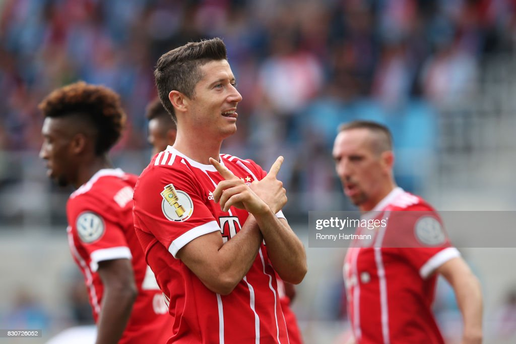 Robert Lewandowski (C) of Muenchen celebrates after scoring his team's third goal during the DFB Cup first round match between Chemnitzer FC and FC Bayern Muenchen at community4you Arena on August 12, 2017 in Chemnitz, Germany.