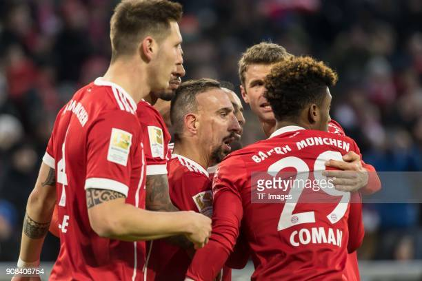 Robert Lewandowski of Muenchen celebrates after scoring his team`s second goal with team mates during the Bundesliga match between FC Bayern Muenchen...