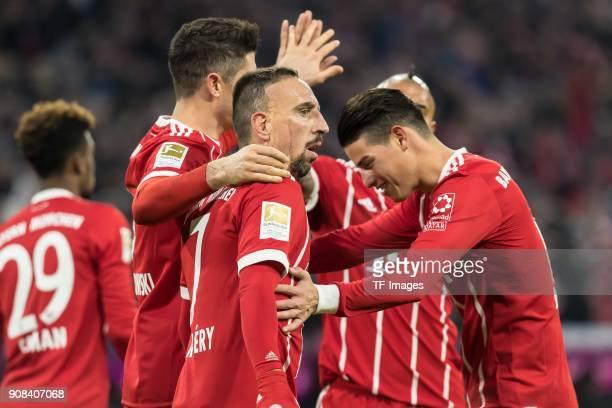 Robert Lewandowski of Muenchen celebrates after scoring his team`s third goal with team mates during the Bundesliga match between FC Bayern Muenchen...