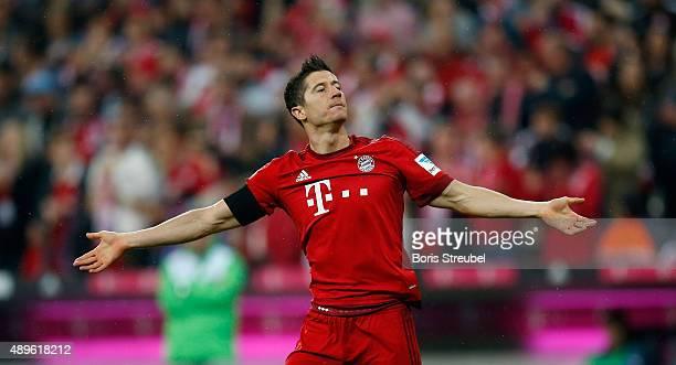 Robert Lewandowski of Muenchen celebrates his team's first goal during the Bundesliga match between FC Bayern Muenchen and VfL Wolfsburg at Allianz...