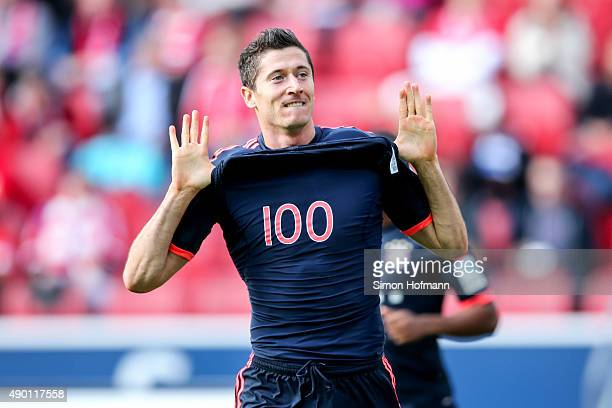 Robert Lewandowski of Muenchen celebrates his team's first goal during the Bundesliga match between 1 FSV Mainz 05 and FC Bayern Muenchen at Coface...